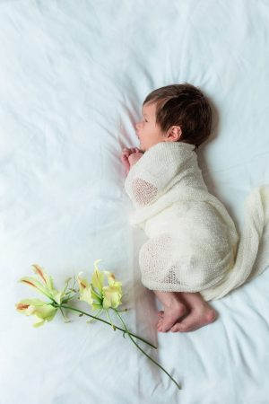 newborn with flower